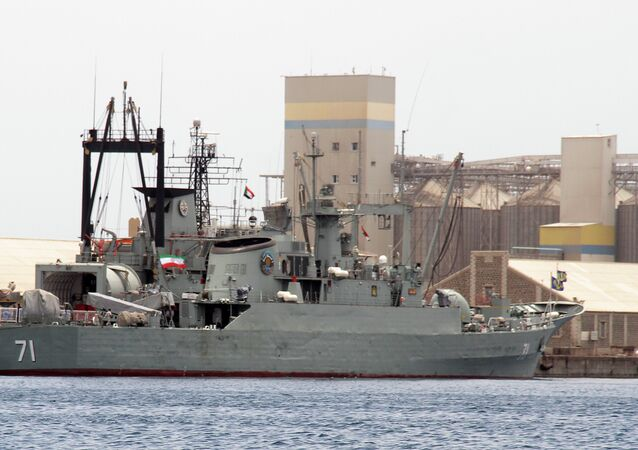 Iranian military ships frigate Alvand (R) and light replenishment ship Bushehr are seen docked for refueling on May 6, 2014 in Port Sudan