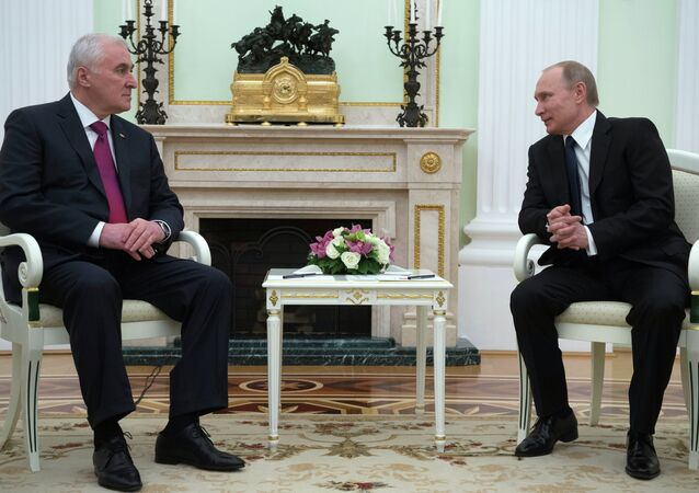 Russian President Vladimir Putin, right, and South Ossetian President Leonid Tibilov meet in the Kremlin