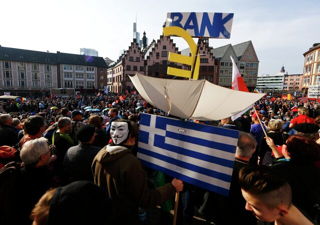 Protesters demonstrate in front of the Roemer in the central square in Frankfurt's old town March 18, 2015, after the inauguration of the European Central Bank (ECB) new headquarters