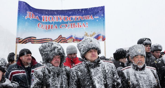 Residents of Petropavlovsk-Kamchatsk at a rally held as part of the Reunification campaign dedicated to the anniversary of Crimea's reunification with Russia