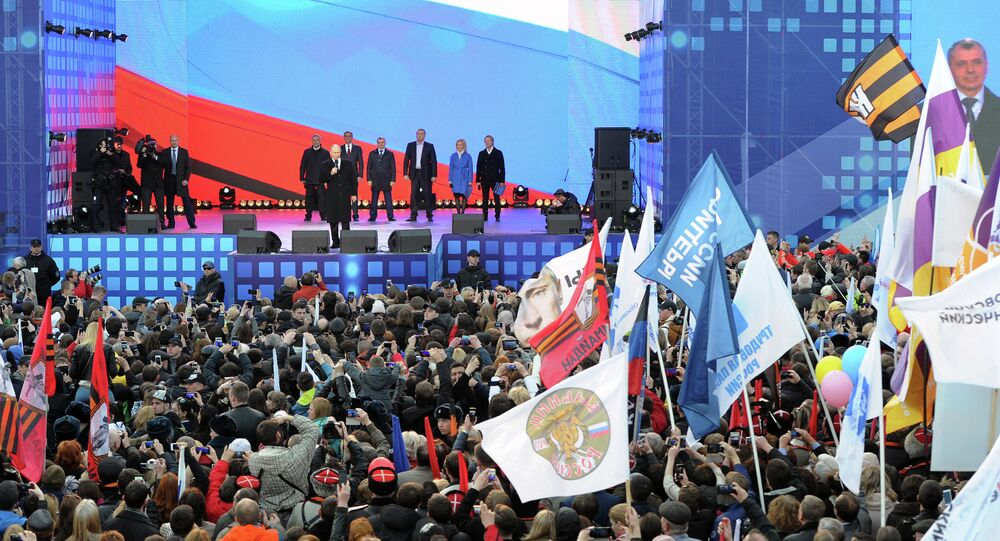 Russian President Vladimir Putin delivers a speech during a festive concert marking the first anniversary of the Crimean treaty signing in central Moscow