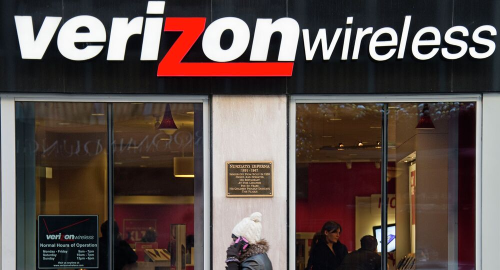 A woman on her cell phone walks past a Verizon Wireless store in Washington