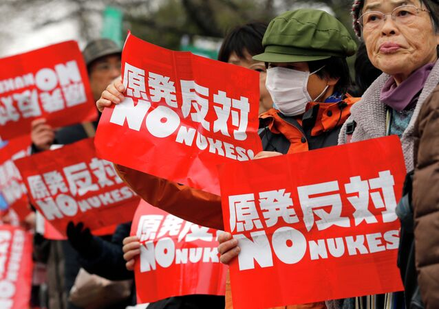 Anti-nuclear protesters hold placards during a rally in Tokyo, Japan, on March 8.