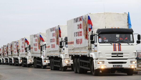 The trucks from the next column of Emercom of Russia with humanitarian aid for inhabitants of Donbass on the Matveev Kurgan check point in the Rostov region - Sputnik International