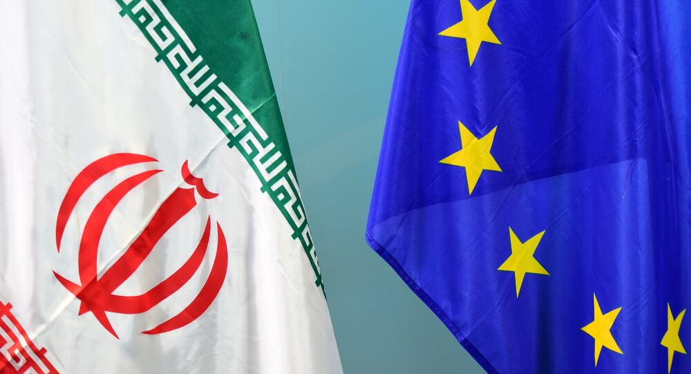 An Iranian (L) and a European flag are set on March 16, 2015