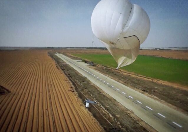 Skystar 180 aerostat system flies over land