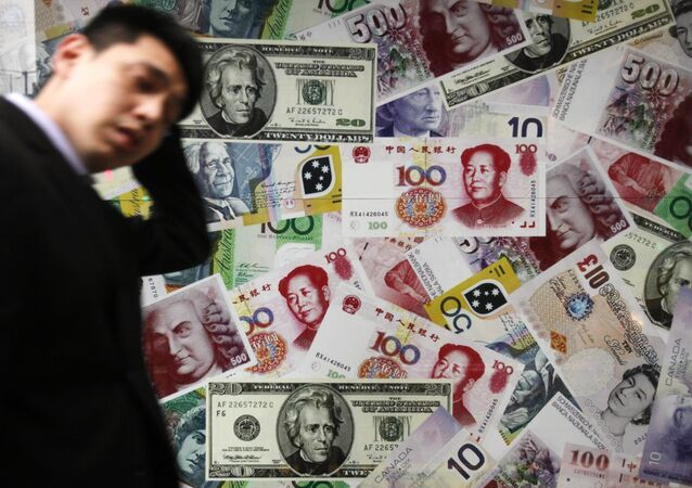 A man walks past a collage of copies of Chinese RMB, U.S. dollar and other foreign bills at a money exchange store in Hong Kong Thursday, April 15, 2010
