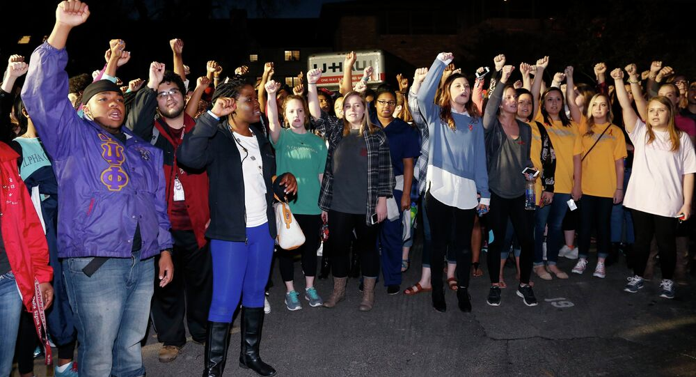 University of Oklahoma students rally outside the now closed University of Oklahoma's Sigma Alpha Epsilon fraternity house during a rally in reaction to an incident in which members of a fraternity were caught on video chanting a racial slur, in Norman, Okla.