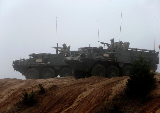 Soldiers of the U.S. Army's 2nd Cavalry Regiment, deployed in Latvia as part of NATO's Operation Atlantic Resolve, ride in armored vehicles named Stryker during a joint military exercise in Adazi