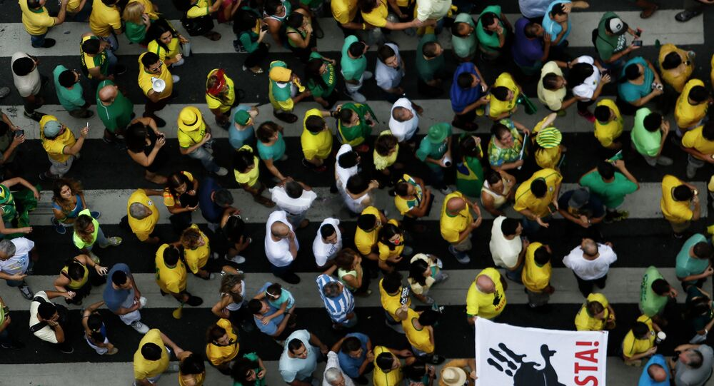 Demonstrators rally to protest against the government of president Dilma Rousseff in Paulista Avenue in Sao Paulo, Brazil on 15 March, 2015