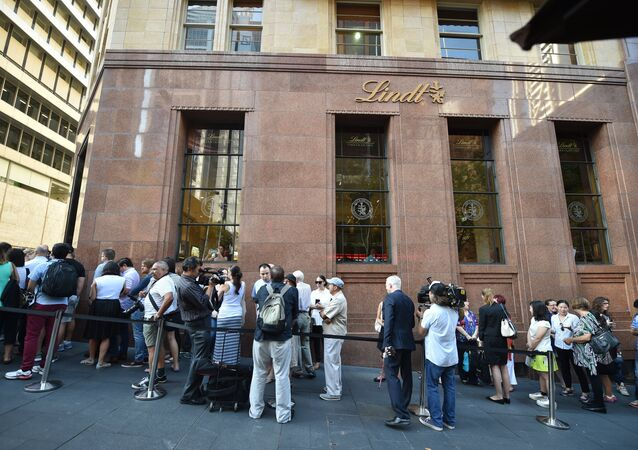 Members of the public queue outside the Lindt Cafe at Martin Place in Sydney ahead of the re-opening on March 20, 2015