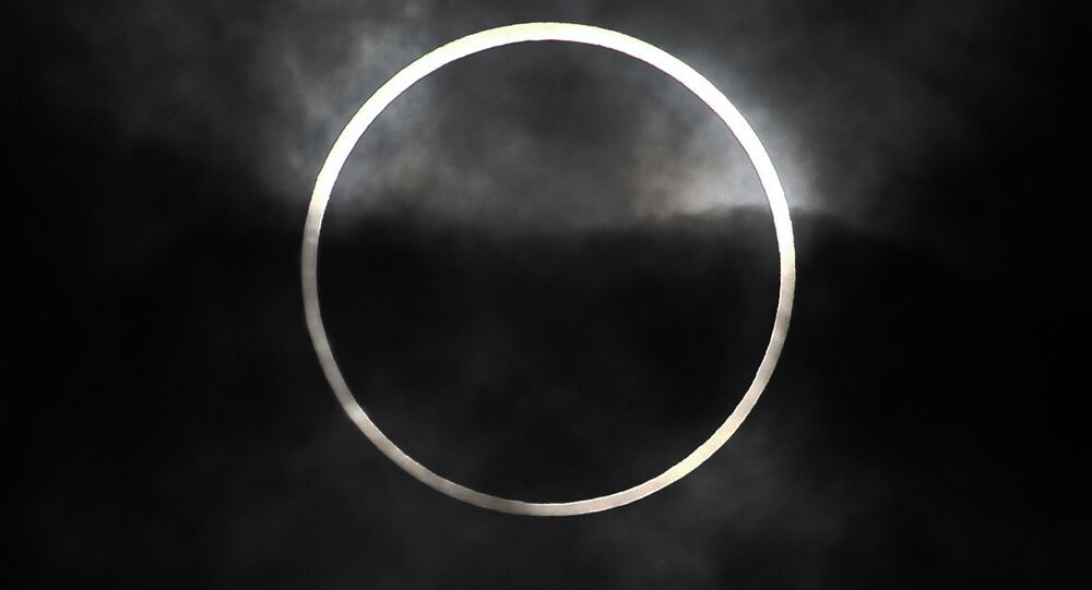 Annular solar eclipse underway, cloudy skies may play spoilsport for sky gazers