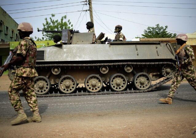 Nigerian troops patrol in the north-eastern Nigerian city of Mubi, some 20 kms (14 miles) west of the Cameroon border