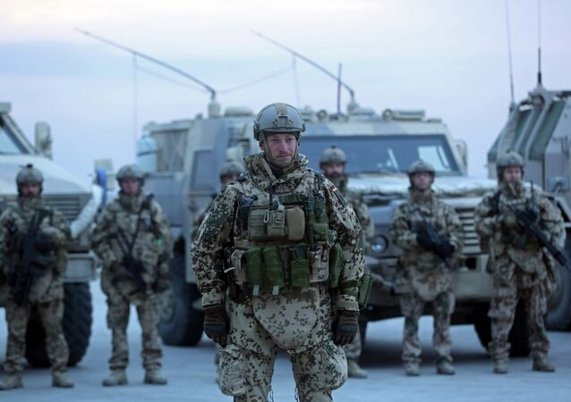 German soldiers stand guard during the NATO Secretary-General Jens Stoltenberg's first visit as head of NATO at German NATO base, Camp Marmal, in Mazar-i Sharif, Afghanistan, Friday, Nov. 7, 2014