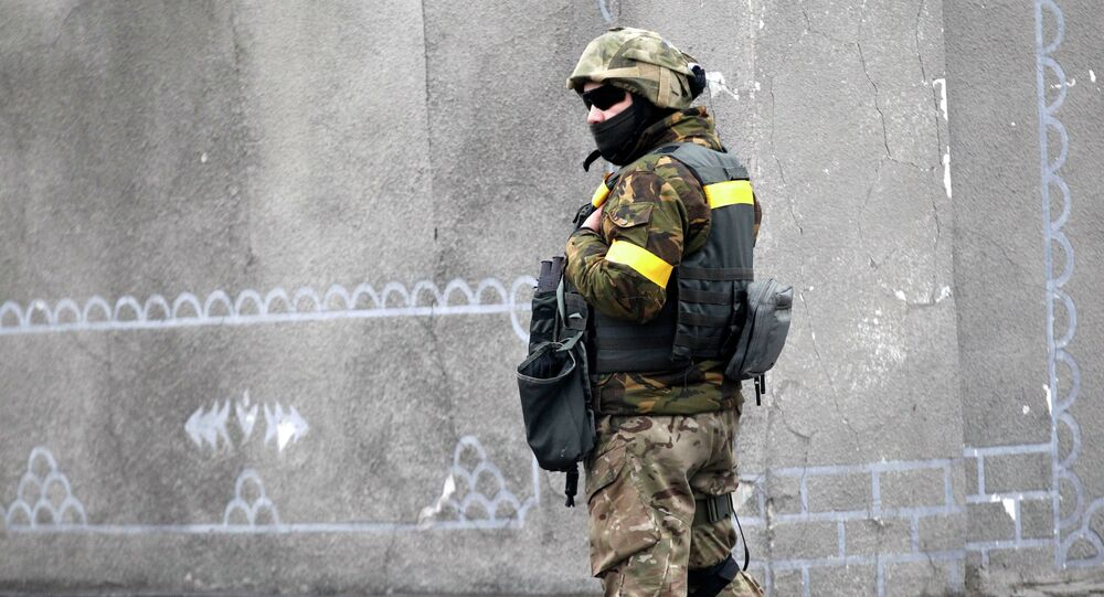 A Ukrainian government soldier stands guard in the town of Debaltseve, Ukraine