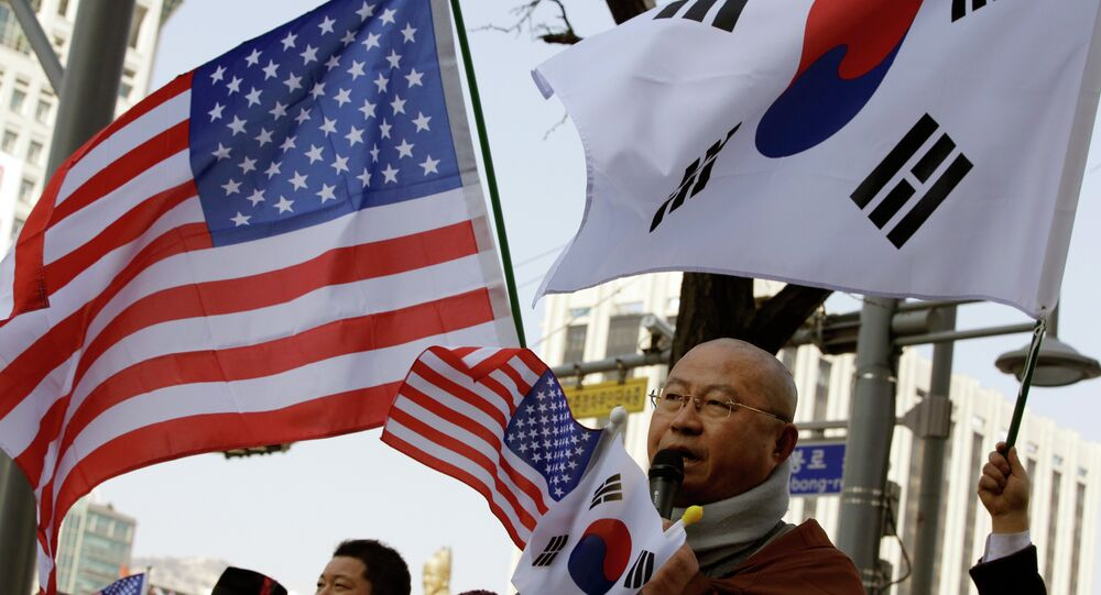 A South Korean Buddhist monk speaks during a rally wishing for a quick recovery of injured U.S. Ambassador Mark Lippert near the U.S. Embassy in Seoul, South Korea