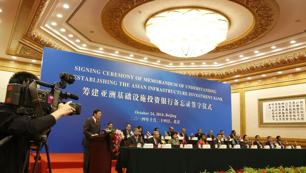 Chinese Finance Minister Lou Jiwei (2nd L) gives a speech for guests at the signing ceremony of the Asian Infrastructure Investment Bank at the Great Hall of the People in Beijing - Sputnik International
