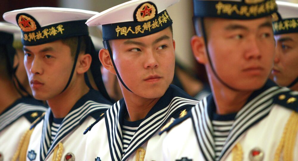 A military honor guard prepares for US Chief of Naval Operations Admiral Jonathan Greenert's visit with Commander in Chief of the PLA Navy Adm. Wu Shengli at a welcoming ceremony at the PLA Navy headquarters outside Beijing, China