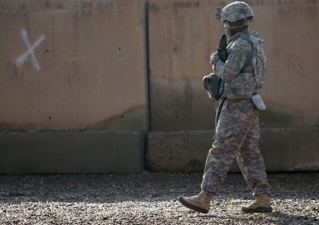 A US soldier walks at the Taji base complex which hosts Iraqi and US troops and is located thirty kilometres north of the capital Baghdad