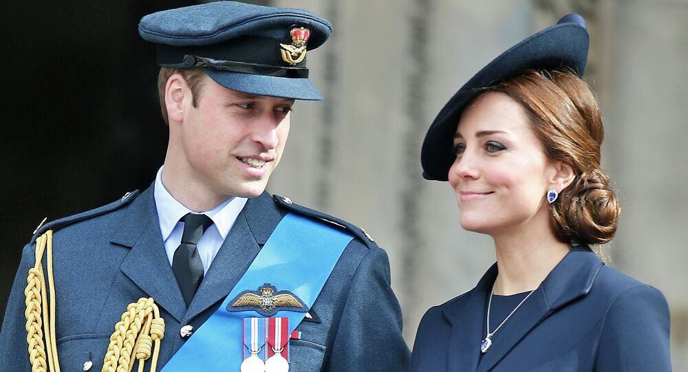 Britain's Duke of Cambridge and Duchess of Cambridge stand at the steps of St Paul's Cathedral, in central London