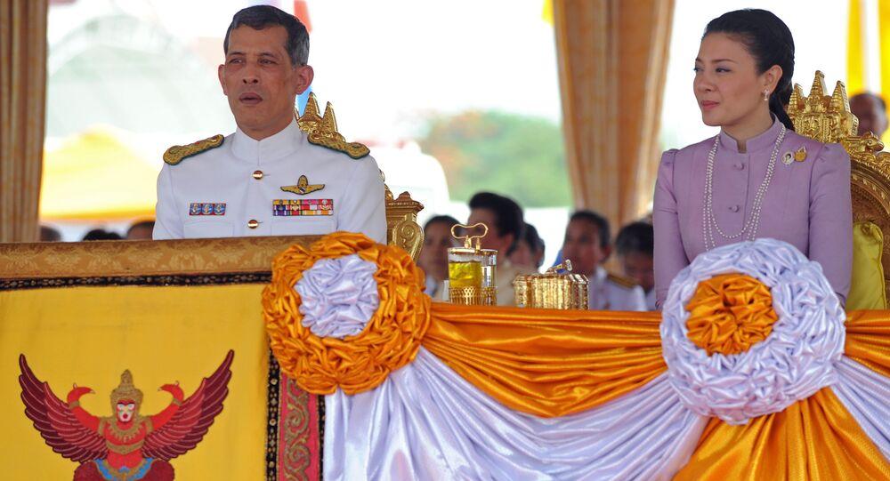 Thai Crown Prince Maha Vajiralongkorn (L) and Princess Srirasmi (R) attend the annual Royal Ploughing Ceremony at Sanam Luang in Bangkok on May 13, 2010