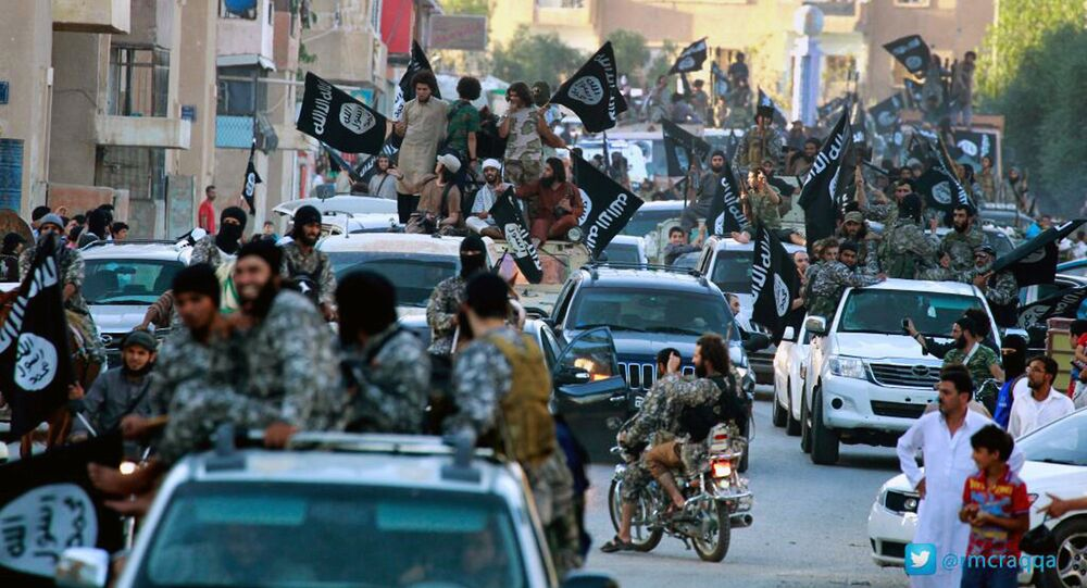 Fighters from the Islamic State group parade in Raqqa