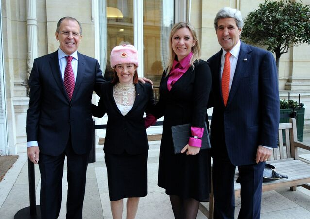 Spokesperson Psaki Poses in a New Hat With Russian Counterpart and Their Respective Bosses