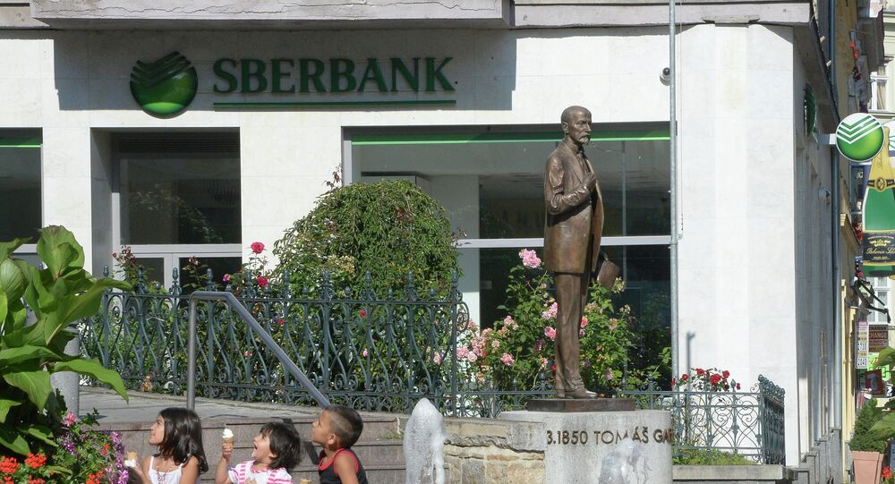 Photo: Monument to Czechoslovakian President Tomas Masaryk near a branch of Sberbank in the town of Karlovy Vary, Czech Republic.