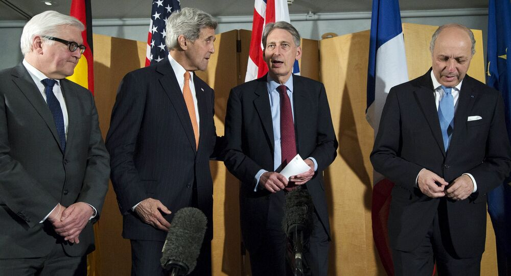 German Foreign Minister Frank Walter Steinmeier (L), U.S. Secretary of State John Kerry (2nd L), British Foreign Secretary Philip Hammond and French Foreign Minister Laurent Fabius (R) talk after Secretary Hammond made a statement about their meeting regarding recent negotiations with Iran over Iran's nuclear program in London, England March 21, 2015