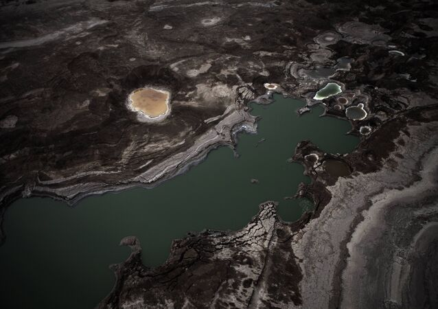 An aerial view photo shows sinkholes created by the drying of the Dead Sea, near Kibbutz Ein Gedi