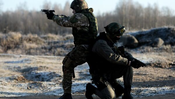 Special Rapid Response Unit personnel practice before going on a mission in Dagestan - Sputnik International