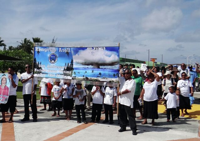 Islanders from nuclear weapons test-damaged Rongelap Atoll march