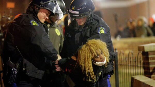 Police officers take a protester into custody Tuesday, Nov. 25, 2014, in Ferguson, Mo. - Sputnik International