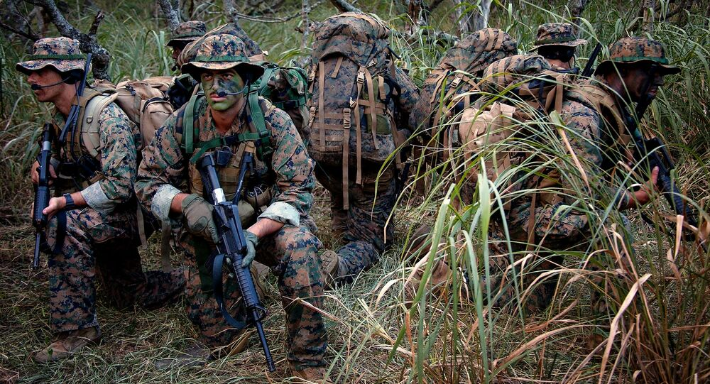 Reconnaissance Marines with 4th Force Reconnaissance Company secure themselves by watching in all directions during their two weeks of annual training at the Marine Corps