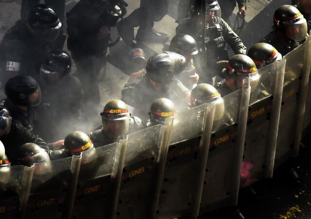 Venezuela's National Guard personnel in riot gear form a line during a protest by opponents to the government of Venezuelan President Nicolas Maduro in Caracas