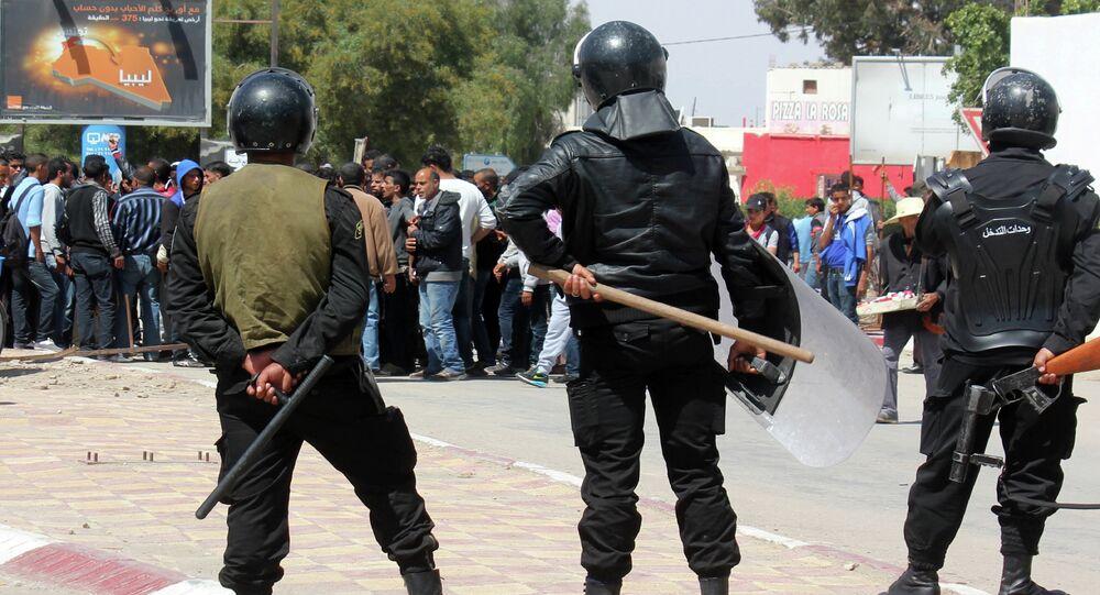 Tunisian riot police face residents of the southeastern Tunisian town of Ben Guerdane