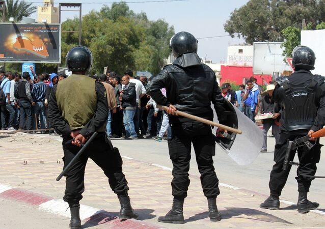 Tunisian riot police face residents of the southeastern Tunisian town of Ben Guerdane