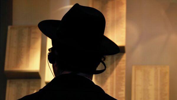 An Ultra-Orthodox Jewish man looks at facsimiles of Oskar Schindler's lists displayed for the public at the Yad Vashem Holocaust memorial museum in Jerusalem - Sputnik International