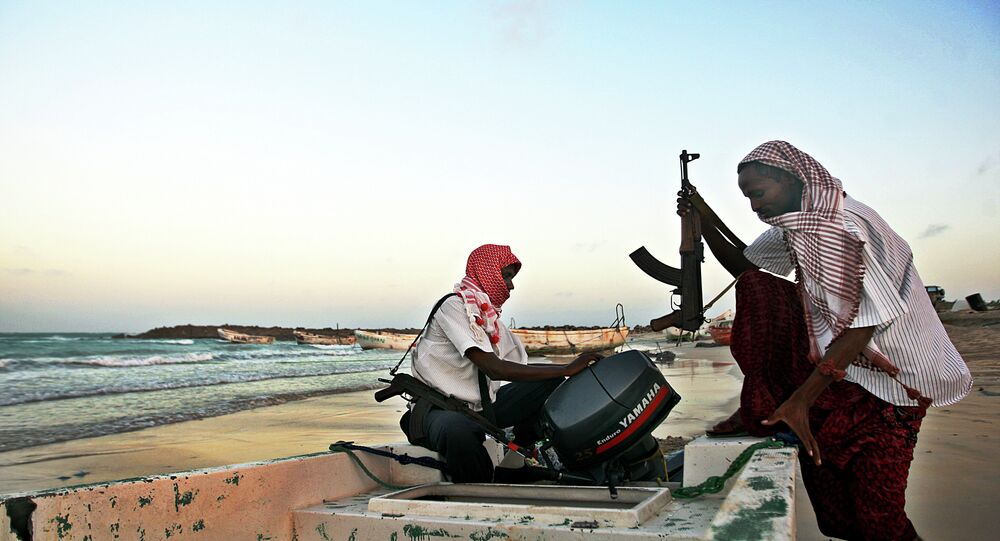 Somali pirates carrying out preparations to a skiff in Hobyo, northeastern Somalia. File photo