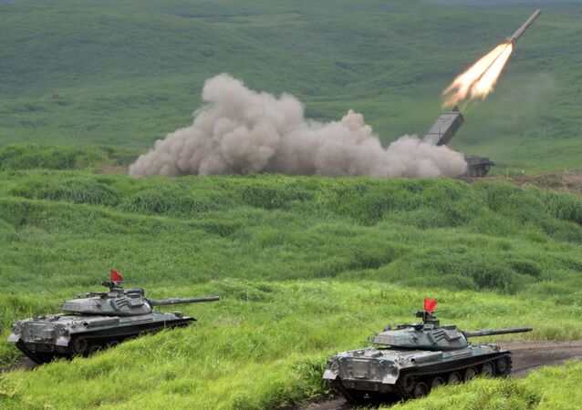 Japan Ground Self Defense Forces' type 92 anti-landmine missile fires while 74 tanks standing by during an exercise in its Higashi-Fuji training ground in Gotemba