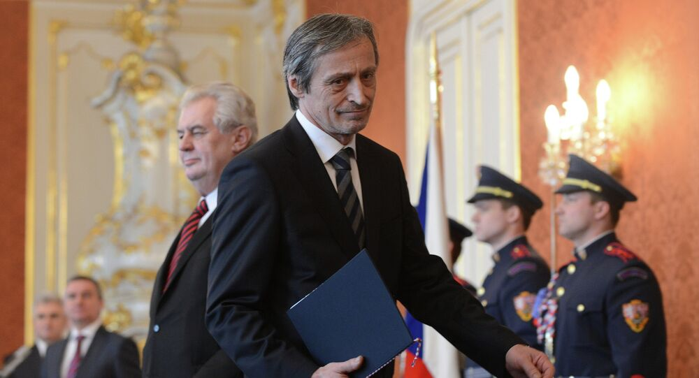 Czech Defence Martin Stropnicky from ANO party leaves after having been appointed by President Milos Zeman (C L)