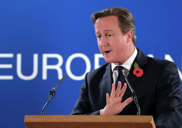 British Prime Minister David Cameron speaks during a media conference after an EU summit at the EU Council building in Brussels