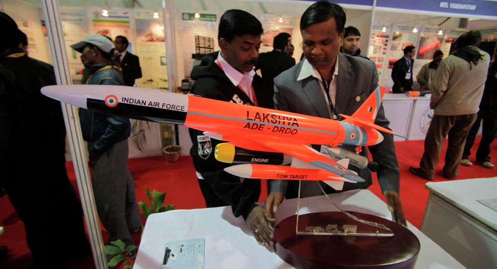 An Indian delegate displays a model of Lakshya, remotely piloted high speed target drone system developed by the Indian Defense Research and Development Organization (DRDO), at the 101st Indian Science Congress in Jammu, India