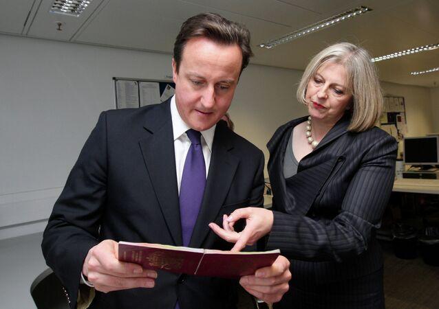 British Prime Minister David Cameron and Home Secretary Theresa May