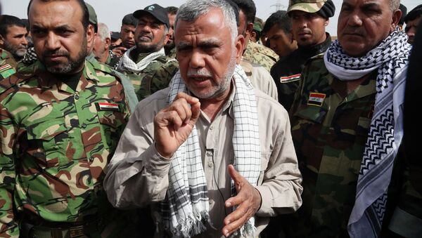 Hadi al-Amiri commander, center, of Iraq's powerful Shiite militias speaks during an interview with The Associated Press on the battlefield near the Iraqi city of Tikrit, 80 miles (130 kilometers) north of Baghdad, Iraq, Friday, March 13, 2015. Al-Amiri accused the U.S. of falling short on promises to help Iraq in its battle against the Islamic State group and called Iranian assistance to Iraqi security forces unconditional. - Sputnik International