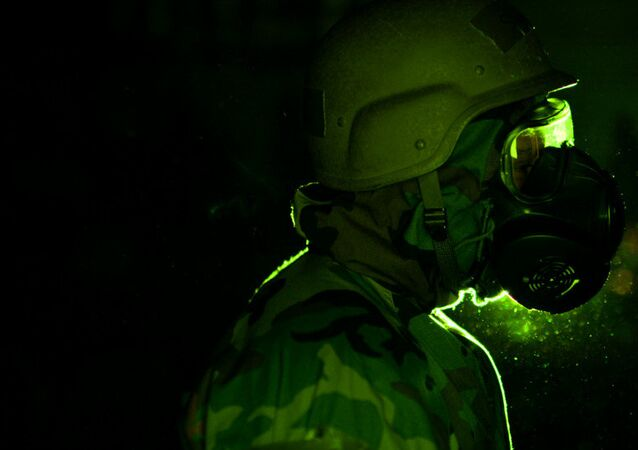 A soldier wearing a gas mask