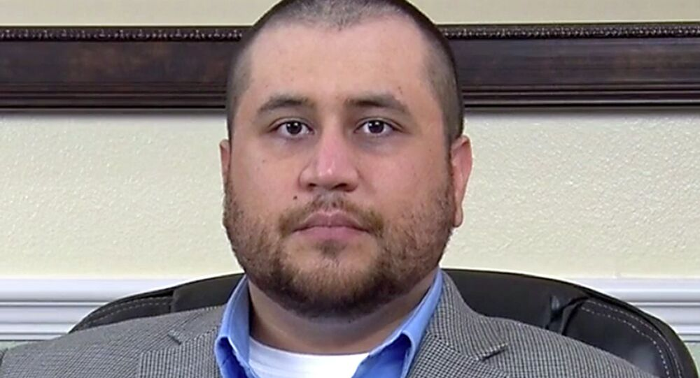 This image taken from a video released by attorney Howard Iken on Wednesday, March 12, 2014, shows George Zimmerman, the former neighborhood watch volunteer who was acquitted of murder for fatally shooting Trayvon Martin, during an interview in Orlando, Fla., on Friday, March 7, 2014