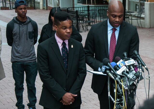 Martese Johnson's lawyer reading a statement to the gathered media on Charlottesville's downtown mall