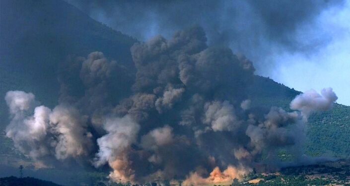 The Kosovo village of Gorozhubi comes under attack by U.S. B-52 bombers Sunday June 6 1999.