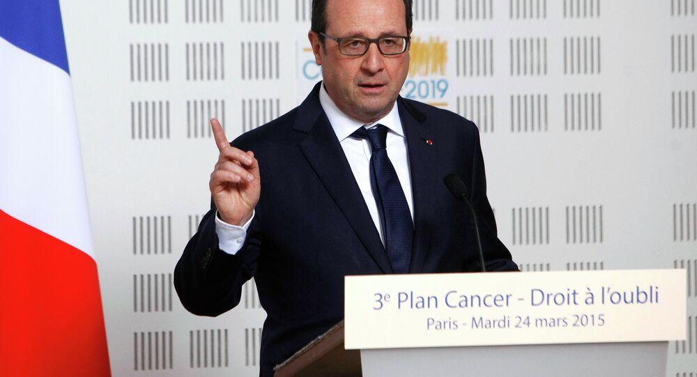 France's President Francois Hollande delivers a speech during a visit at the Ligue Contre le Cancer (League Against Cancer) centre in Paris, March 24, 2015.